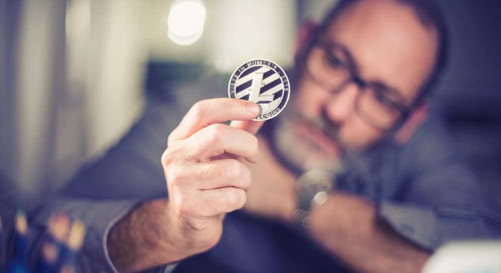 A businessman wondering the future of Litecoin. Source: Shutterstock.com