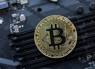 Bitcoin. New virtual money. Bitcoins lie on the video card, concept of mining. Blockchain and mining concept. Source: shutterstock.com