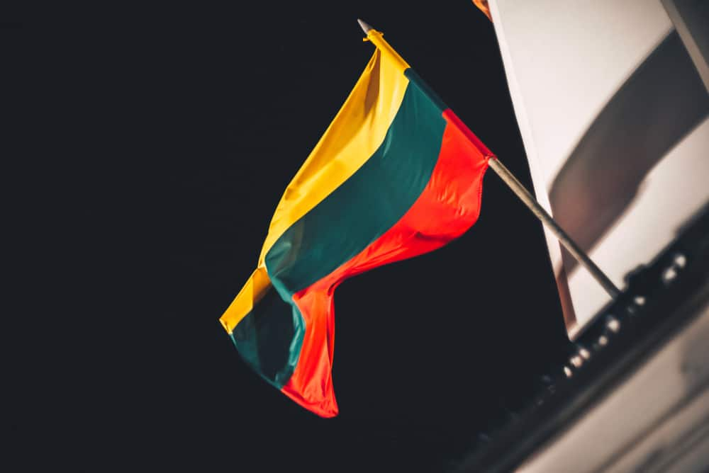 Closeup view of Lithuanian flag in the wind. Source: Shutterstock.com