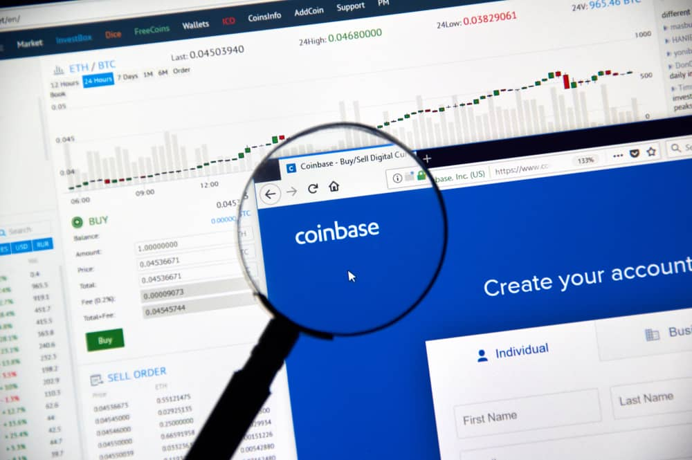 Coinbase cryptocurrency exchange website under magnifying glass. Source: Shutterstock.com