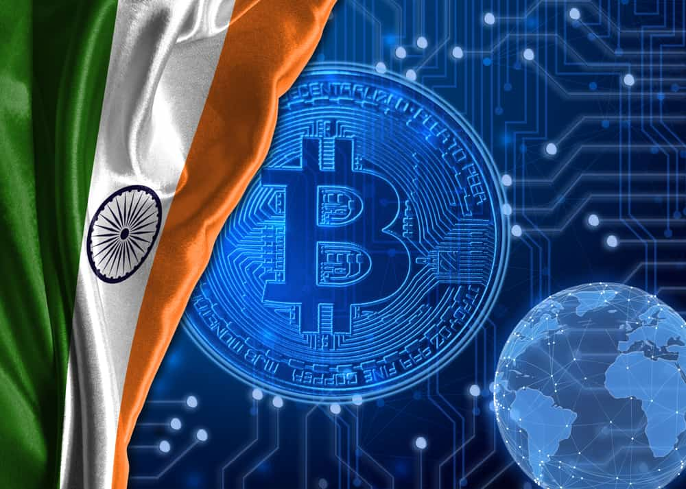 Flag of India against the background of cryptocurrency Bitcoin. Source: shutterstock.com