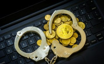 Golden Bitcoins (Cryptocurrency) with Handcuffs on computer keyboard.. Source: shutterstock.com