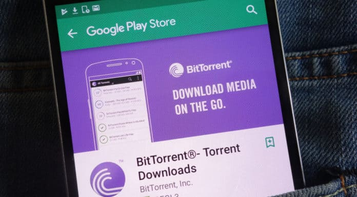 KONSKIE, POLAND - JUNE 02, 2018 BitTorrent app on Google Play Store website displayed on smartphone hidden in jeans pocket. Source: shutterstock.com