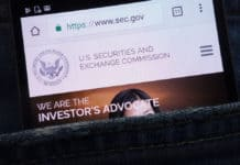 KONSKIE, POLAND - JUNE 02, 2018 U.S. Securities and Exchange Commission website displayed on smartphone hidden in jeans pocket. Source: shutterstock.com