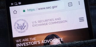 KONSKIE, POLAND - JUNE 02, 2018 U.S. Securities and Exchange Commission website displayed on smartphone hidden in jeans pocket.