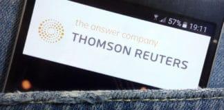 KONSKIE, POLAND - MAY 17, 2018 Thomson Reuters website displayed on smartphone hidden in jeans pocket. Source: shutterstock.com