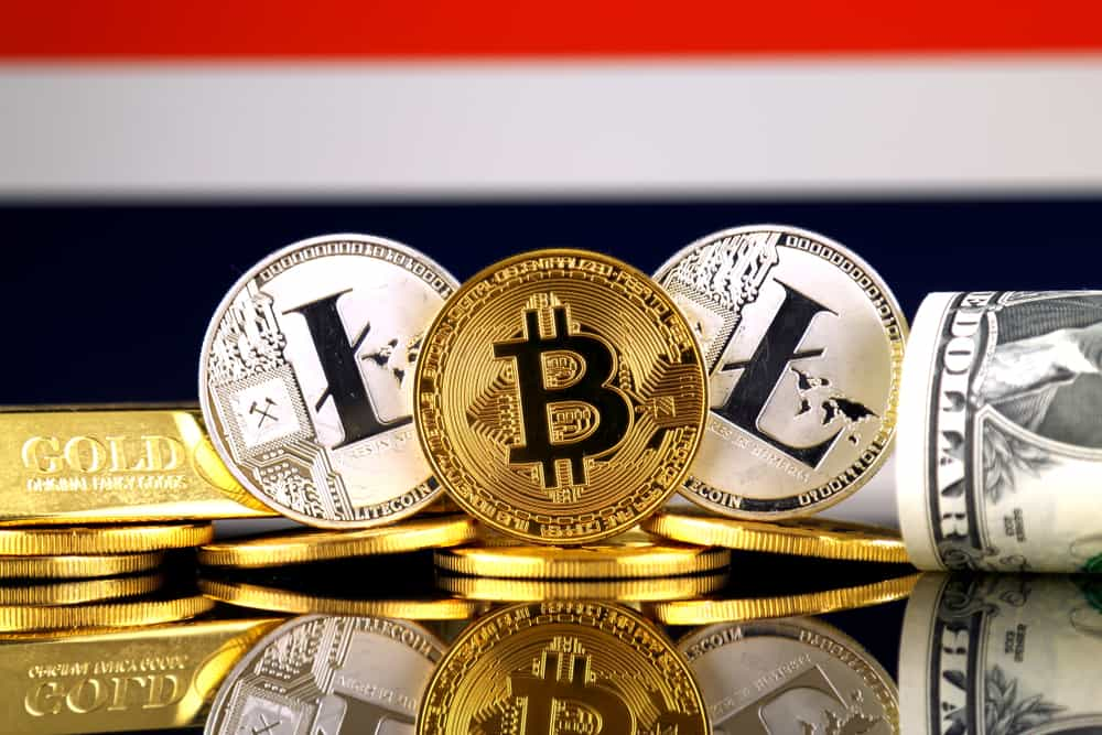 Physical version of Bitcoin, Litecoin, gold, US Dollar and Thailand Flag. Source: Shutterstock.com