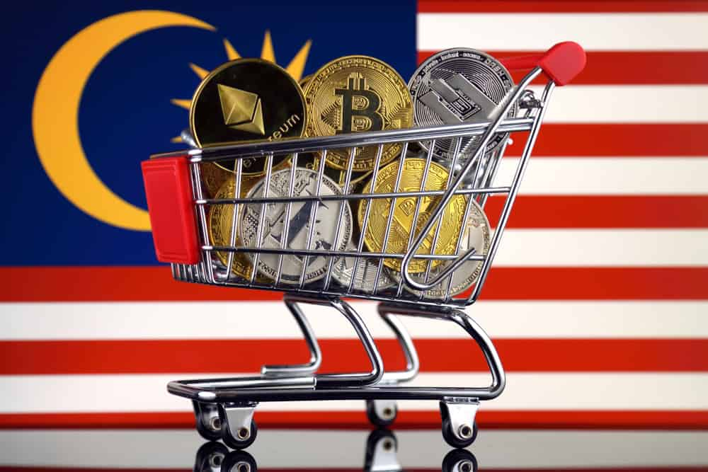 Shopping Trolley full of physical version of Cryptocurrencies (Bitcoin, Litecoin, Dash, Ethereum) and Malaysia Flag. Source: shutterstock.com
