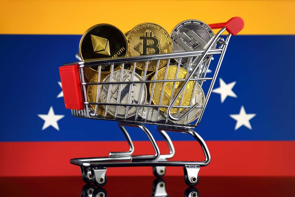 Shopping Trolley full of physical version of Cryptocurrencies (Bitcoin, Litecoin, Dash, Ethereum) and Venezuela Flag. Source: shutterstock.com