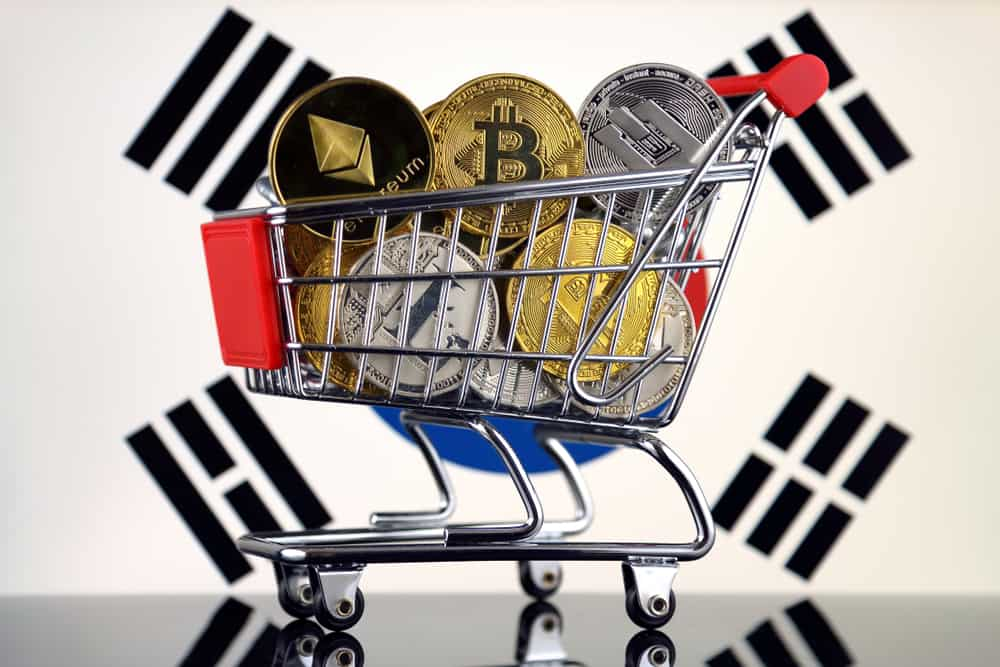 South Korea flag and shopping trolley full of physical version of Cryptocurrencies (Bitcoin, Litecoin, Dash, Ethereum). Source: Shutterstock.com