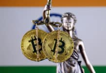Symbol of law and justice, physical version of Bitcoin and India Flag. Source: Shutterstock.com