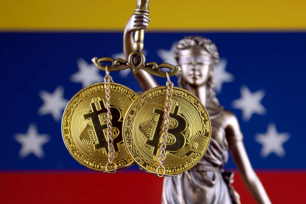 Symbol of law and justice, physical version of Bitcoin and Venezuela Flag. Source: Shutterstock.com