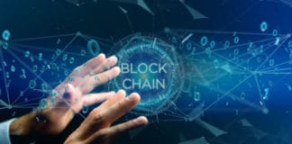 View of a Blockchain title with 0 and 1 data flying over. Source: shutterstock.com