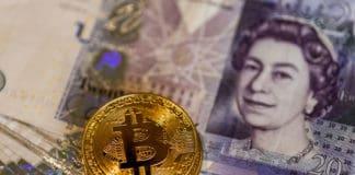 Bitcoins over British pound notes. Source: shutterstock.com