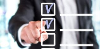 Businessman with checklist. Source: shutterstock.com
