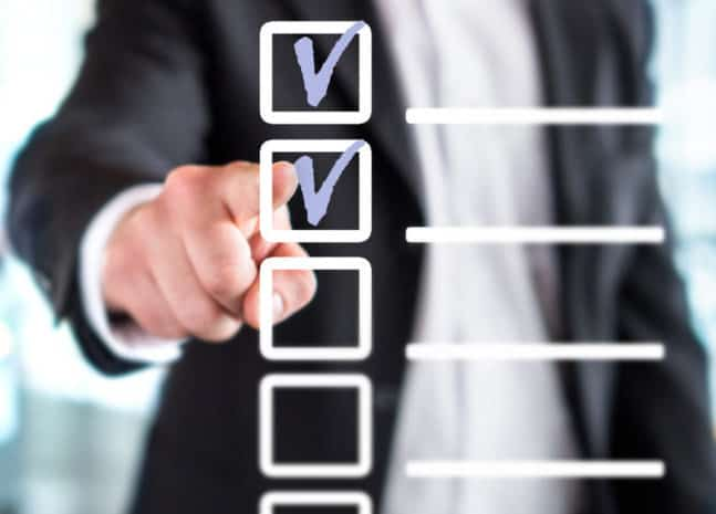 Businessman with checklist. Source: shutterstock.com