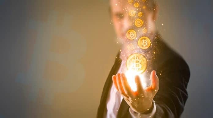 Concept of man creating Bitcoins with his hand. Source: shutterstock.com