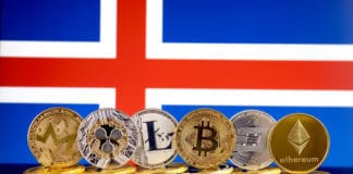 Physical version of Cryptocurrencies (Monero, Ripple, Litecoin, Bitcoin, Dash, Ethereum) and Iceland Flag. Source: shutterstock.com