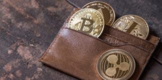 Popular cryptocurrency in leather wallet on wooden table top. Source: shutterstock.com