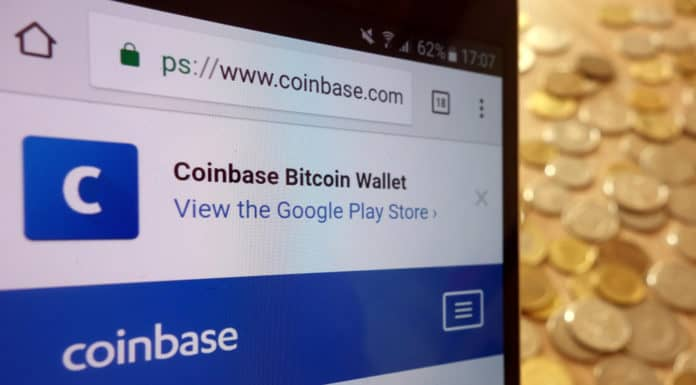 KONSKIE, POLAND - MAY 08, 2018: Coinbase cryptocurrency exchange website displayed on smartphone and stack of coins. Source: shutterstock.com
