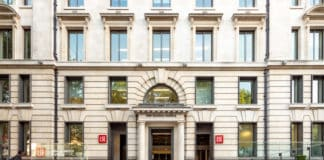 LONDON, UK - 17 MAY 2018: The entrance and facade to the New Academic Building of the London School of Economics (LSE) in the heart of London's legal district, Lincoln's Inn Fields. Source: shutterstock.com