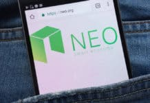 KONSKIE, POLAND - JUNE 01, 2018: NEO cryptocurrency website displayed on smartphone hidden in jeans pocket.