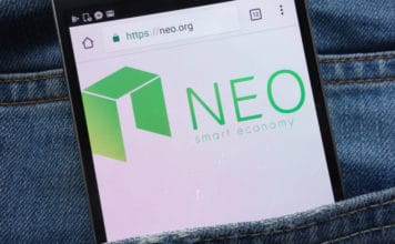 KONSKIE, POLAND - JUNE 01, 2018: NEO cryptocurrency website displayed on smartphone hidden in jeans pocket. Source: shutterstock.com