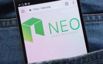 KONSKIE, POLAND - JUNE 01, 2018: NEO cryptocurrency website displayed on smartphone hidden in jeans pocket.