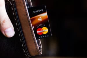 Ryazan, Russia - February 27, 2018: Credit or debit card of Mastercard brand in a leather wallet. Source; shutterstock.com