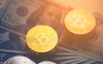 Golden bitcoin with dollar background. conceptual image for crypto currency. Source: shutterstock.com