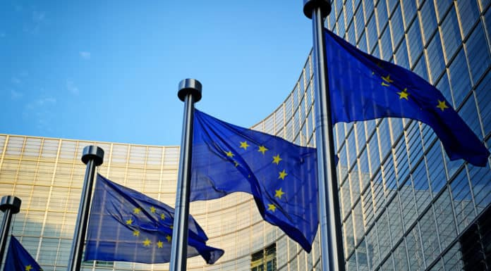 EU flags in front of European Commission in Brussels. SOurce: shutterstock.com