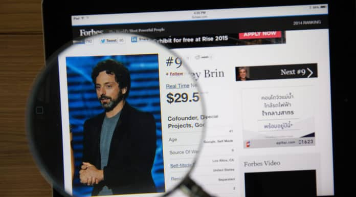 CHIANGMAI, THAILAND - March 31, 2015: Photo of Forbes article page about Sergey Brin on a ipad monitor screen through a magnifying glass. Source: shutterstock.com