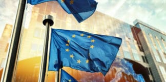 EU flags waving in front of European Parliament building. Brussels, Belgium. Source: shutterstock.com
