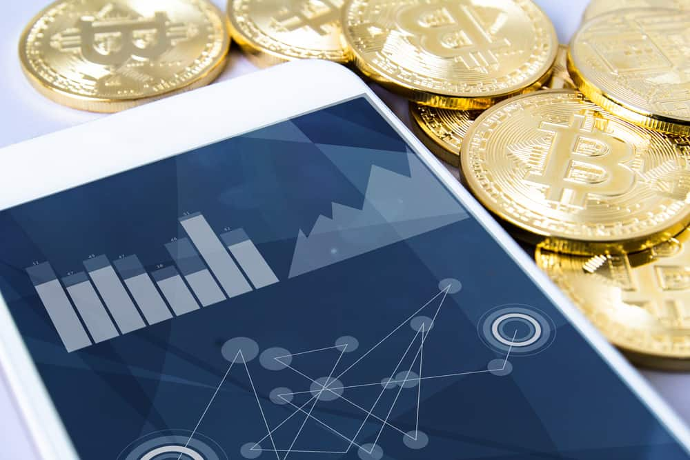 bitcoins and smartphone. Source: shutterstock.com