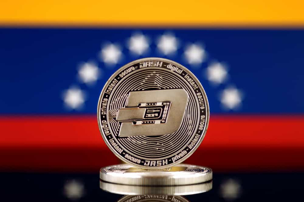 Dash coin in front of the Venezuela flag. Source: shutterstock.com