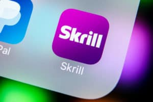 Sankt-Petersburg, Russia, March 22, 2018: Skrill application icon on Apple iPhone X smartphone screen close-up. Skrill app icon. Skrill is an online electronic finance payment system. Source; shutterstock.com
