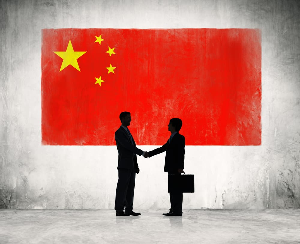 Partnership concept with Chinese flag on background