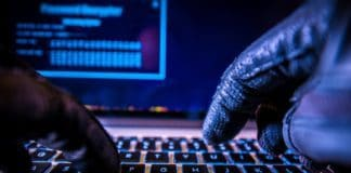 Payments System Hacking. Online Credit Cards Payment Security Concept. Hacker in Black Gloves Hacking the System. Source: shutterstock.com