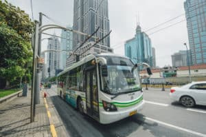 SHANGHAI, CHINA - MAY 05, 2016: Electric powered hybrid bus charging. Source: shutterstock.com