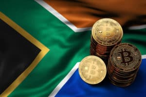 Stack of Bitcoin coins on Southern Africa flag. Situation of Bitcoin and other cryptocurrencies in South Africa concept. 3D Rendering. Source; shutterstock.com