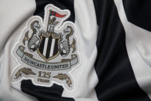 BANGKOK, THAILAND -OCTOBER 18 The Logo of Newcastle United football club on an official jersey on October 18,2017. Source: shutterstock.com