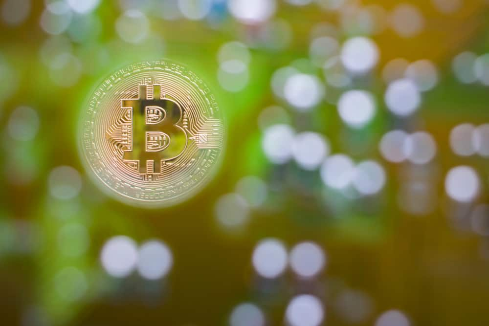 Bitcoin against blurred background