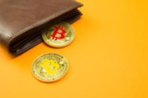 Bitcoin coin virtual money in wallet. Concept of blockchain technology, digital money, e-wallet, cryptocurrency for shopping e-commerce or shop. Bitcoin is a cryptocurrency form of electronic cash. Source: shutterstock.com