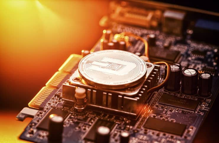 Dash Cryptocurrency coin on a PC computer graphic card, crypto currency mining concept. Source: shutterstock.com