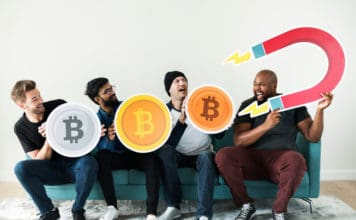 Group of diverse friends sitting on couch cryptocurrency concept. Source; shutterstock.com