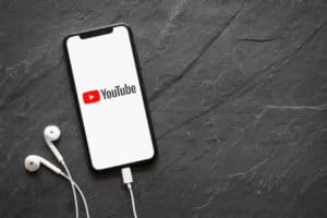 Riga, Latvia - March 25, 2018 Latest generation iPhone X with YouTube logo on the screen. Source: shutterstock.com