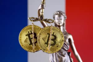Symbol of law and justice, physical version of Bitcoin and France Flag. Prohibition of cryptocurrencies, regulations, restrictions or security, protection, privacy. Source; shutterstock.com
