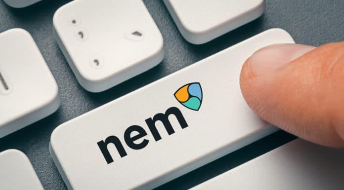 finger pressing computer key with nem coin logo. crypto mining concept. Source: shutterstock.com