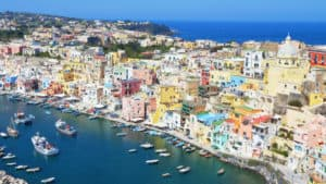Procida, Naples, Italy - March 31, 2017: colored fisherman houses and sea in the island of Procida, in the Naples Gulf, Italy. Source: shutterstock.com