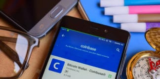 BEKASI, WEST JAVA, INDONESIA. SEPTEMBER 2, 2018 : Bitcoin Wallet - Coinbase dev app on Smartphone screen. Bitcoin Wallet is a freeware web browser developed by Coinbase Inc. Source: shutterstock.com